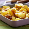 fried potatoes in a frying pan, rustic style